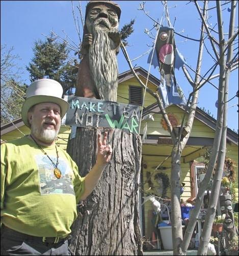Jimbo gives the peace sign in the front yard of his house, located at West 24th Avenue and Monroe Street, which is full of memorabilia of the hippie culture that he has been a part of since the 1960s. Many in Eugene know him as the ultimate hippie.