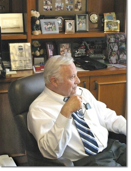 John Davitt gazes out his office window, reflecting on his 21-year presidency.