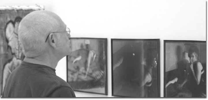 Gary Freeman, an art student, views the photography of Chynna Jenkins whose triptych illustrates the theme of