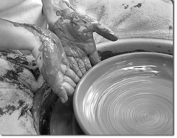 Functional items, such as this plate being formed on the potter's wheel by advanced student Muna Karram, are part of the selection for sale along with decorative and sculptural pieces.