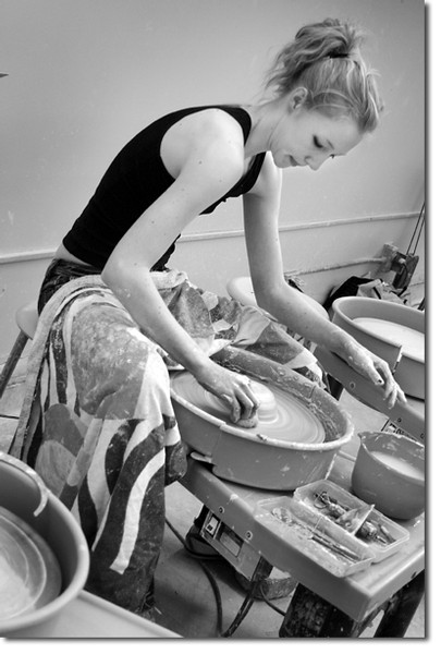 Andrea Benson, 18, who is studying dance as well as ceramics, hones her skills on the potter's wheel.