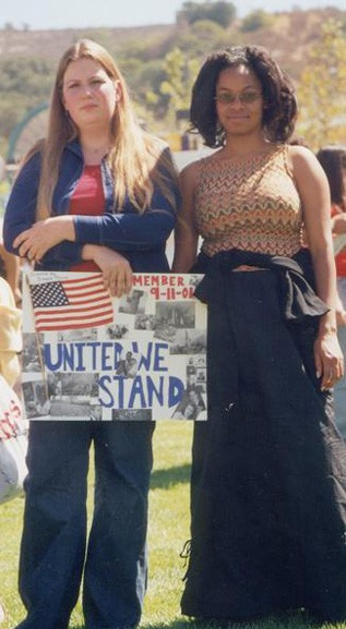 Dana Price, left, and Rosita Ellis show pride in their country.