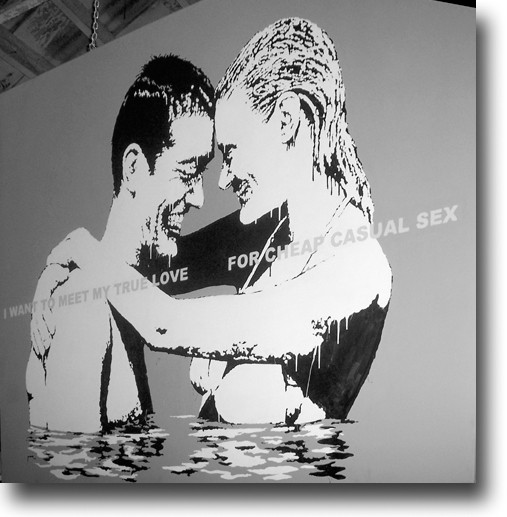 Banksy's work incorporates pop art and mixed messages, like the true meaning of love.