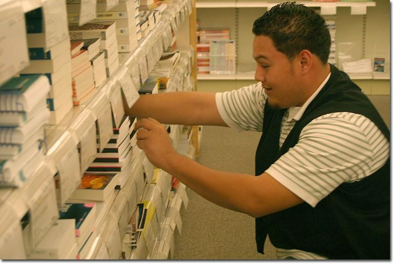Student worker Felipe Martinez got his job at the bookstore through the Job Placement Center.