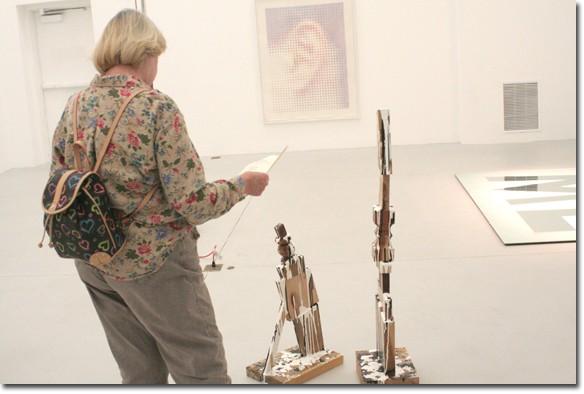 Student Mary Jessica Bonham studies a piece by Daniel Mendel-Black.