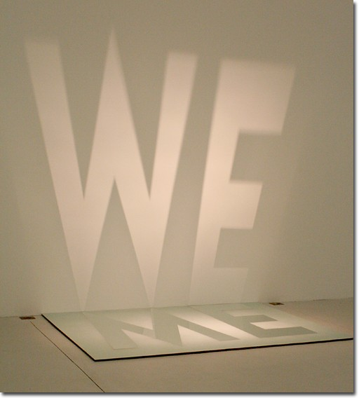 Me, We, by Dewey Ambrosino, lies on a piece of clear sealant. Ambrosino is inspired by Muhammad Alis famous Me, We poem.