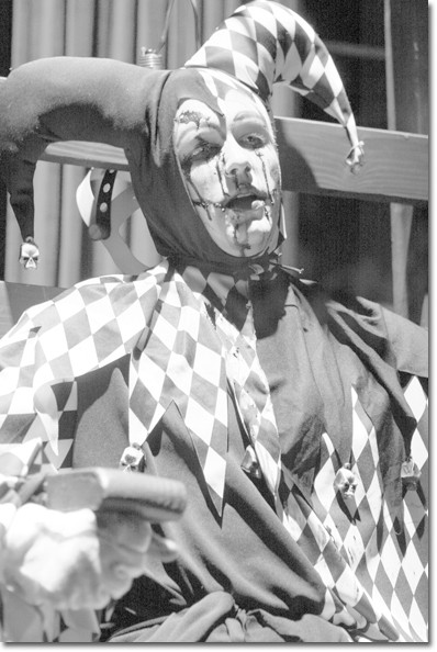 A bloody jester terrorizes unsuspecting spectators at
