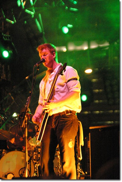 Josh Homme from Queens of the Stone Age rocks out on stage before a massive crowd in the heart of Downtown L.A.