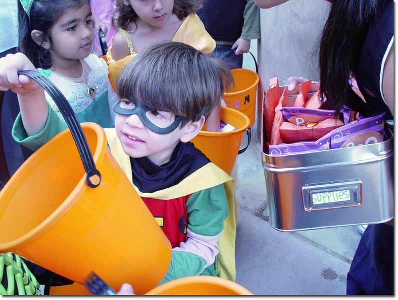 Lucas, dressed as Robin, goes trick-or-treating on campus with children from the Child Development Center.