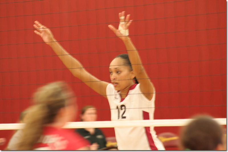 Middle blocker Susie Marco guards the net at Friday's game against Bakersfield.