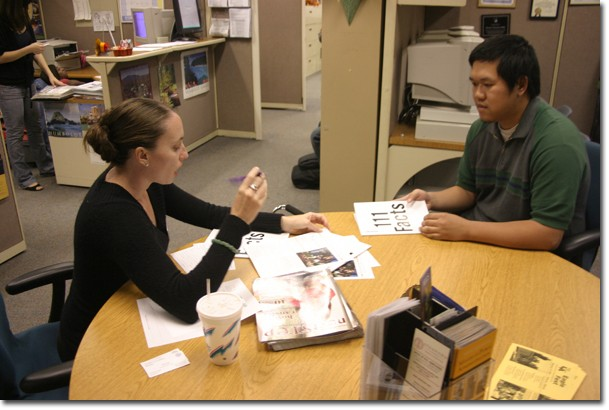 UC Riverside representative Jolene Tuz assists Binn Le, a 21-year-old business major.