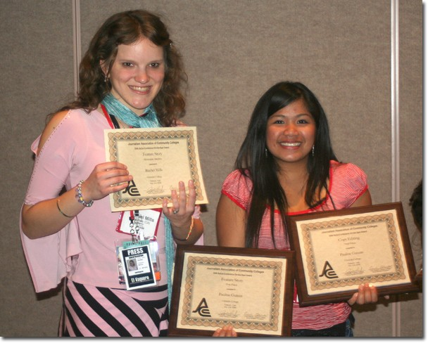 Staff writer Rachel Mills, left, and news editor Pauline Guiuan show off their awards at Cal State Fullerton on Nov. 4.