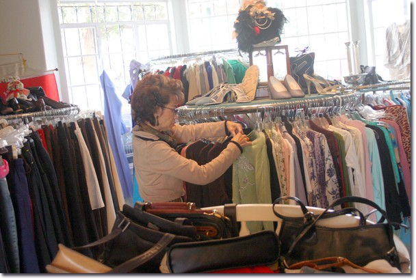 Volunteer Vanessa Bui sorts clothes donated to the Y by designer Karen Kane.