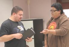 Speech and Debate club memebers Eric Garcia and Lou de la Rosa practice during a collaborative workshop session.