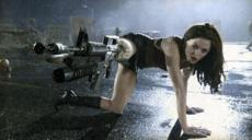 Rose McGowan as go-go dancer Cherry Darling, fights off a horde of zombies in Planet Terror.