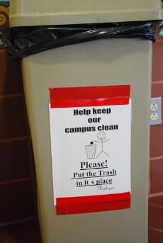 In spite of visible signs on campus asking people to help maintain the campus clean, trash still makes it onto the floor.