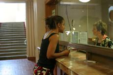 Shauna Murray pays her fees to Sandra Fleischer, part-time tuition office employee, at the fee drop window.
