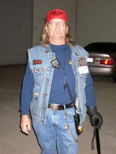 Mike Geiger, GCC computer graphics major and Love Ride volunteer shows up at 2 a.m. Sunday at Glendale Harley-Davidson ready to help set-up.