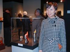 Serina Nakazawa, grand prize winner of the third International Small Teapot Show, poses with her teapots.