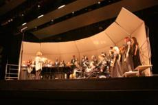 The College Choir, directed by Dr. Jayne Campbell, left foreground, performs classic pieces for an enthusiastic audience in the auditorium on May 31.