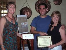 Vickie McConnell, Downtown Glendale Merchants Association, left, and Dawn Lindsey, GCC Vice President of Instructional Services present Thomas Mose Abbott with first place honors.