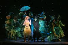 Reluctant roommates Galinda and Elphaba enjoy One Short Day in Oz, the Emerald City.