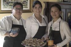 The culinary arts department was hired to cater and serve at the Freeman/Macierz wedding. Culinatry arts majors Maria Falco, left,  Wendy Dominguez and Maritsa Chow serve appetizers (above). Chow hopes to expand catering opportunities for Glendale student