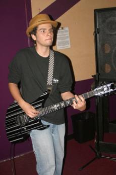 Mike Huezo is Tessatura's guitarist.