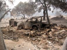 Theater arts instructor Ken Grays home in Big Tujunga Canyon, his car burned inside his garage. The Forest Service estimated that 132 vehicles were destroyed and 14 were damaged by the flames.