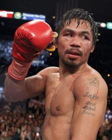 PAC MAN CHEWS UP COMPETITION: Manny Pacquiao won by unanimous decision against Joshua Clottey.