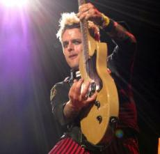 MUSICAL MAYHEM: Billie Joe Armstrong's guitar riffs wow audience.