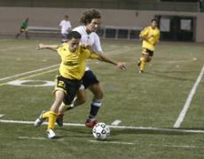 GOT SCURVY?: Vaquero freshman Jonathan Torres fends off a Pirate during Friday night's 2-2 tie.