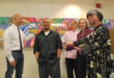 Art lab tech Mark Gens, at right, from left,  Manny Bracamonte, Cafeteria Director Nancy Jordan, Associate Dean Jan Swinton and Art Professor Susan Sing are pictured at the mural dedication. The mural, bottom, 30-by-140 inches in acrylic and spray paint o