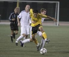 NO HOLDING HIM BACK: A Fighting Owl defender tries to hold back Vaquero Yader Arita to no avail, during the 2-1 Vaquero victory over Citrus on Oct. 15.