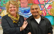 KEEPING IT REAL: Art Professor Caryl St. Ama, above left, and artist Manny Bracamonte are seen in front of his painting Friday in the cafeteria.