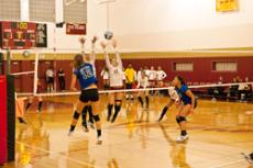 REACH FOR THE SKY: Lady Vaquero Roxanne Domines, 9, goes up for a block against Vivien Reece of Santa Monica College.