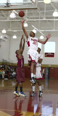 BASKETBALL SEASON TIPS OFF IN STYLE: Glendale's Robert McQueen, 40, goes up for two points.