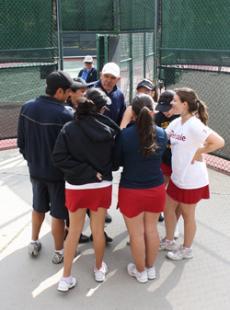 TEAMWORK: The Lady Vaqueros huddle with head coach Bob Donaghy before the loss to Santa Barbara  on Thursday.