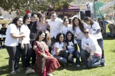 Faculty advisor Paris Noori is joined by members of the Persian Student Association at the Nowruz festival.