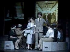 Two on an Island uses simple sets and elaborate projections as part of its stage design.