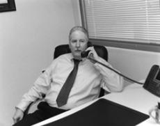 ON THE LINE: Stephen P. Wagg, former Glendale Community College chief of police, accepts a call in between taking questions from a GCC student. Wagg has become the source of mystery among the police department and the school itself, the reason for his lea