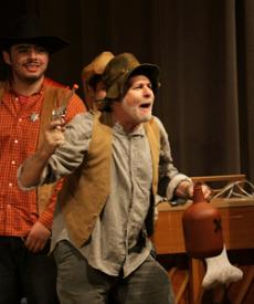 SPEAK NOW OR FOREVER HOLD YOUR PEACE: In the Golden Cowboy wedding ceremony skit, Renato Mejia (left) plays a sheriff observing Ira Heffler who portrays the bride-to-be's uninvited and irate husband just before he guns down a startled bridegroom.