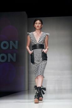 ON THE CATWALK: A runway model wears a houndstooth dress from Seth Aaron Hendersons fall collection. Designer Alicia Wood, of MsWood, designed the Geta (Chinese/Japanese traditional footwear).