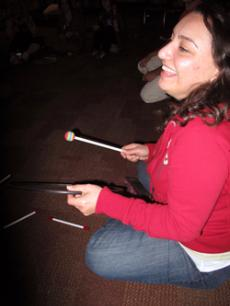 CAN'T BEAT THIS: Suzie Shatarevyan keeps it steady during the drum circle at the Fast for Darfur event.