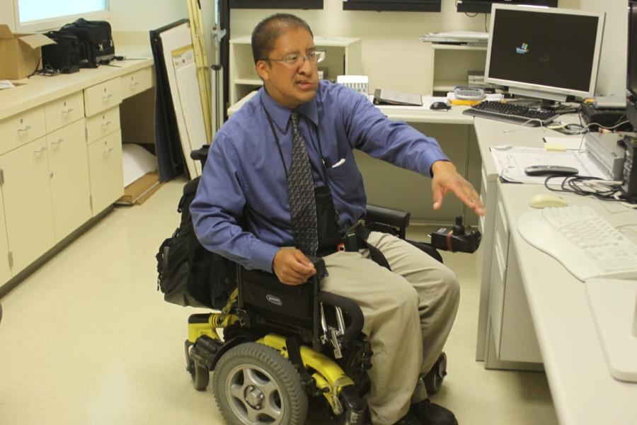 SUCCESSFUL STUDENT WORKER: Jorge Acevedo combines his love of law enforcement with advocacy for disabled access.
