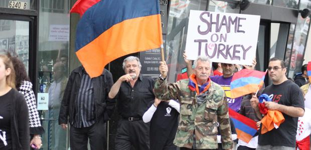 NEVER+FORGET%3A+Garo+Armoudikian+waves+an+Armenian+flag+and+leads+protesters+to+the+Turkish+consulate+on+April+24.