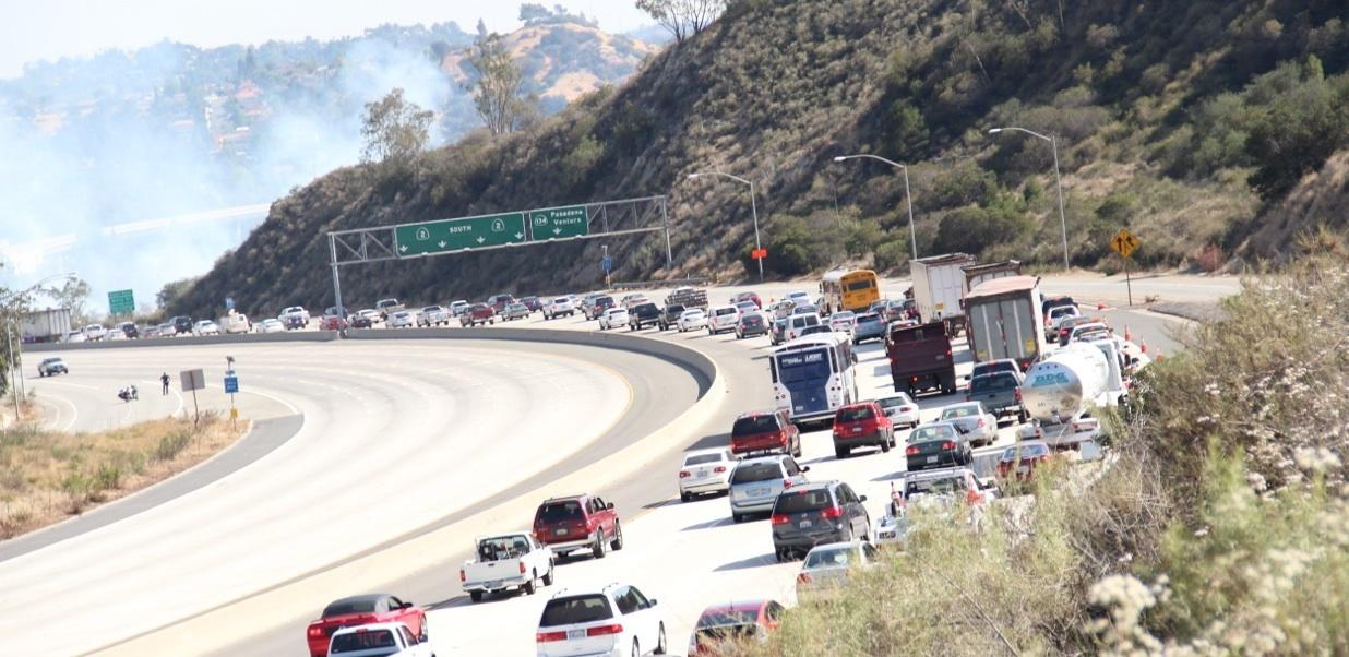 A brush fire between the 134 and 2 freeways closed a section of the 2 freeway in both directions  Friday.