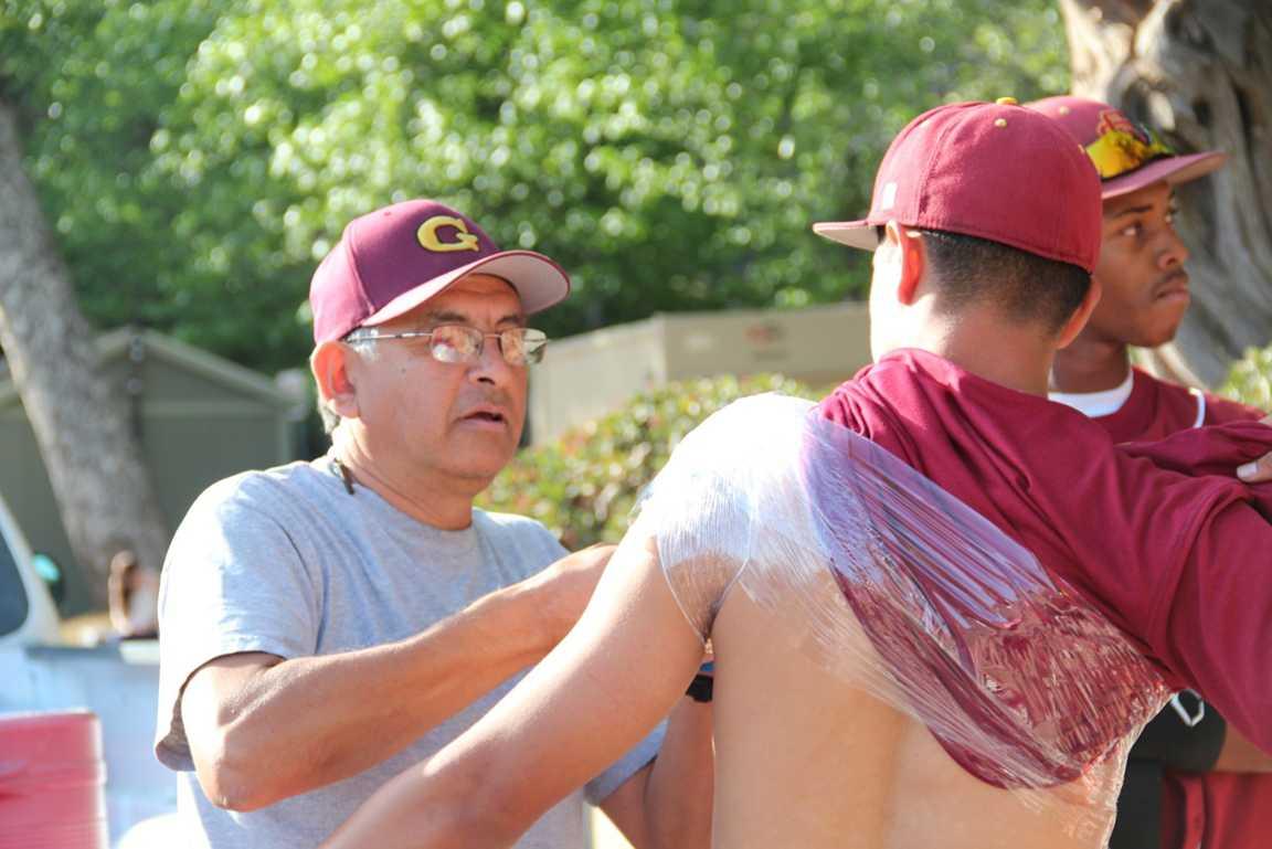 COLD SHOULDER: Trainer Jose Gomez works on left-handed pitcher Gary Aruna.