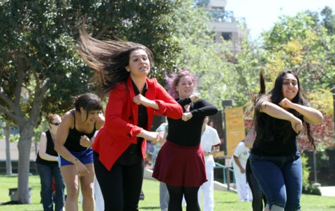 Student Services Technician Suzanna Sargsyan leads students, friends and faculty in a choreographed remix of Uptown Funk. Media Arts students were on hand to film the event on Monday at Plaza Vaquero..