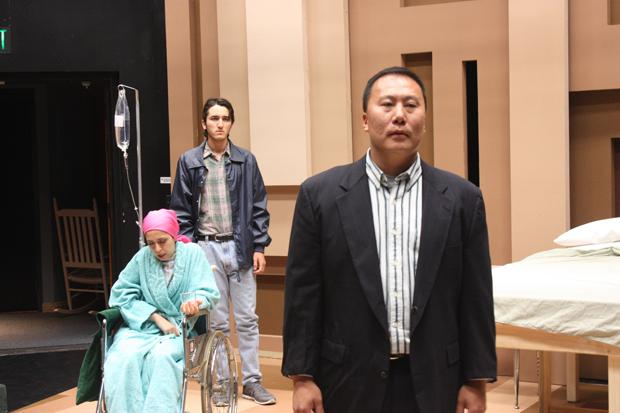 A LOOK AT DEATH: Actors (left to right) Shaghineh Gharepety, Eddie D'Angelo and Steve Yim perform in award-winning playwright, E.M. Lewis's 'Infinite Black Suitcase.'